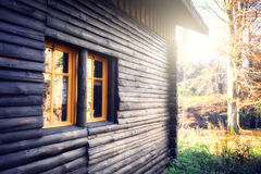 Wooden cabin in autumn forest Stock Images