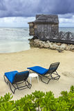 Wooden cabin and beach chairs Stock Image
