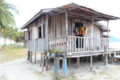 A Wooden Cabin on Beach. A wooden cabin on the white beach, photo taken on an island of Malaysia Royalty Free Stock Photo
