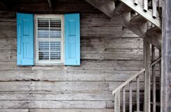 Wooden cabin with blue shutters royalty free stock photos