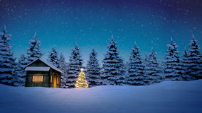 Wooden cabin and christmas tree. Lightened christmas tree in front of wooden cabin in snow at night with pine trees in background stock image