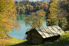 Wooden cabin in fall at a lake Royalty Free Stock Photos