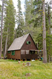Wooden cabin in forest Stock Photo