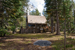 Wooden cabin in forest Royalty Free Stock Image