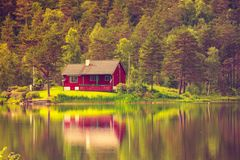 Wooden Cabin In Forest On Lake Shore, Norway Stock Image