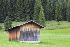 Wooden cabin located in a rural area of the Bavarian Alps stock photos