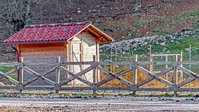 Wooden cabin on mountain Meta in the national park of Abruzzo royalty free stock images