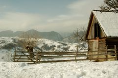 Wooden cabin in the mountains. In winter Royalty Free Stock Images