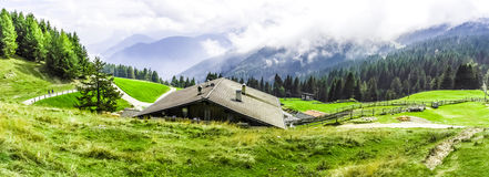 Wooden cabin in the mountains Stock Images