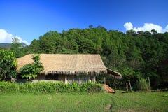 Wooden cabin near the mountain. In Thailand Stock Photo