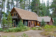 Wooden cabin in scenic forest Stock Photos