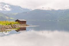 Wooden cabin in the shore of a fjord, Norway. Wooden cabin in the shore of a fjord in Norway Stock Photos