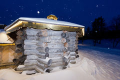 Wooden cabin in snow background Royalty Free Stock Photo
