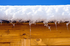 Wooden cabin with snow-hat Royalty Free Stock Image