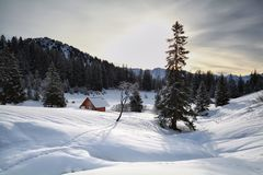 Wooden cabin in snowy Alps Stock Photo