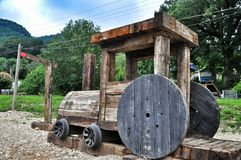 Wooden cabin train. Wooden cabin of a locomotive on the Playground made of railway sleepers and coils. Guamka . Krasnodar region Stock Photo