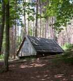 Wooden cabin in the woods Stock Image