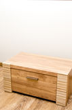 Wooden cabinet. A wooden cabinet against a wall stock photo