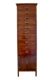 Wooden Cabinet. Dark brown tall wooden cabinet with 10 drawers in frontal view Royalty Free Stock Images