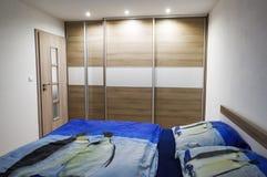 Wooden cabinet in bedroom stock image