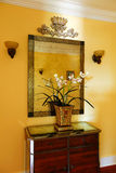 Wooden cabinet with decorative flowers and mirror Stock Photo