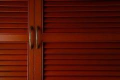 Wooden cabinet door with metal handle Royalty Free Stock Photos