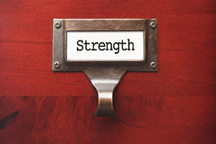 Wooden Cabinet with Strength File Label Stock Images