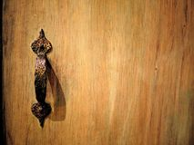 Wooden cabinet with vintage bronze handle. stock images
