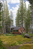 Wooden cabins in forest. Exterior view of wooden cabins in picturesque forest near Wrights lake, California, U.S.A stock image