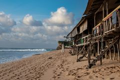 Wooden cafe on Bali beach, indian ocean royalty free stock image