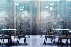 Wooden cafe interior, tables and chairs double. Modern cafe interior with wooden walls, a concrete floor, square tables and wooden chairs. Close up. 3d rendering Stock Photography