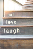 Wooden cafe stairs with word texts  Stock Photos