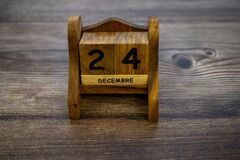 Wooden calendar with christmas 24 december date in french language. Seasonal holiday concept. Eve Christmas.Winter time. Empty