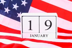 Wooden calendar with the date of January 19 on the American flag. Birthday Robert Edward Lee. Wooden calendar with the date of January 19 on the American flag Stock Photo