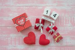 The wooden calendar, 14 February, consists of a box of red hearts written for you and hearts placed side by side with a pink royalty free stock images