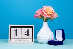 Wooden calendar, vase and rings. Romantic offer for Valentine`s Day. Gift for a holiday from a beloved man stock photos