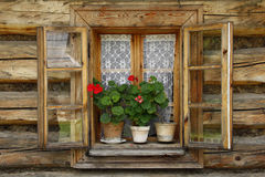 Wooden calmness window. In historic village Royalty Free Stock Image