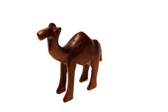 Wooden camel. Souvenir figure of a wooden camel. Isolated on white background Royalty Free Stock Photo