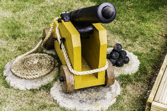Wooden Cannon and Rope. Image of Wooden Cannon as a decorative item in the garden Stock Photo
