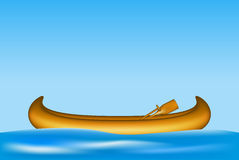 Wooden canoe with paddles floating on water Stock Photo