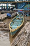 Wooden canoe in river port royalty free stock photos