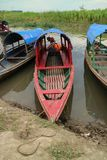 Wooden canoe in river port stock images