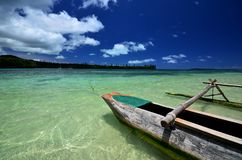 Wooden canoe on tropical island royalty free stock photo