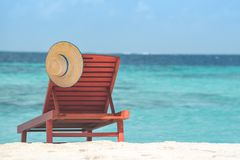 Wooden canvas chair on a beautiful tropical beach stock photo