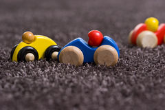 Wooden car. S on deep-pile carpet Royalty Free Stock Image