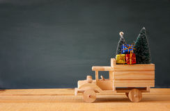 Free Wooden Car Carrying A Christmas Tree Stock Photo - 79299470