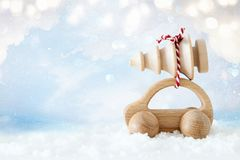 Wooden car carrying a christmas tree royalty free stock image