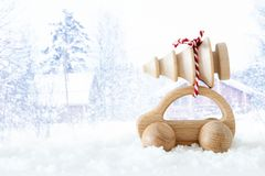 Wooden car carrying a christmas tree in front of dreamy and abstract magical winter landscape. royalty free stock photo