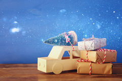 Wooden car carrying a christmas tree and gifts Stock Photography