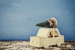 Wooden car carrying a christmas tree Royalty Free Stock Photo